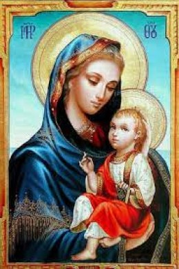 """Mary aka """"Queen of Heaven"""" with Tammuz aka """"Jesus"""" with sun worship disks behind their heads."""