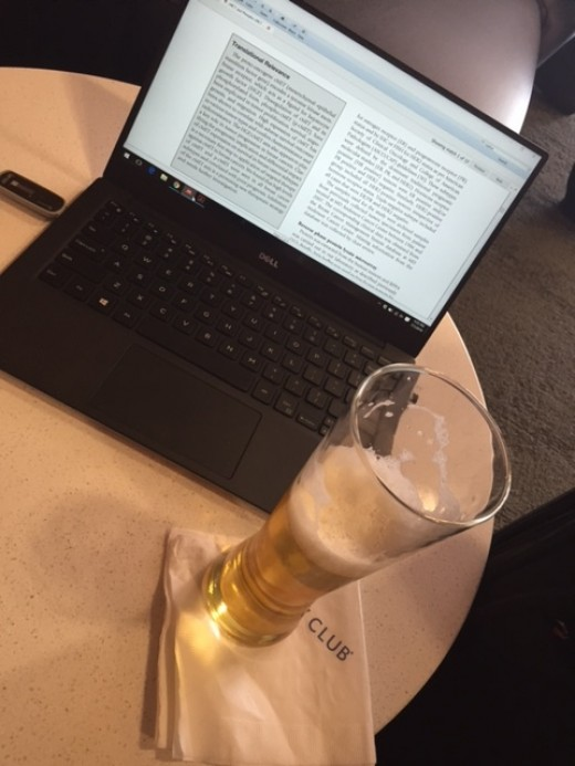 Enjoying a glass of beer and catching on some work at the Delta Skyclub O'Hare