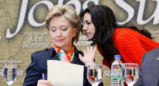 Then Democratic presidential hopeful, Hillary Rodham Clinton, left, has a word with aide