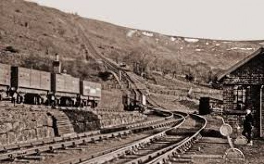 Incline Bottom, the view from beside the brakeman's hut showing four early wooden bodied wagons awaiting the '