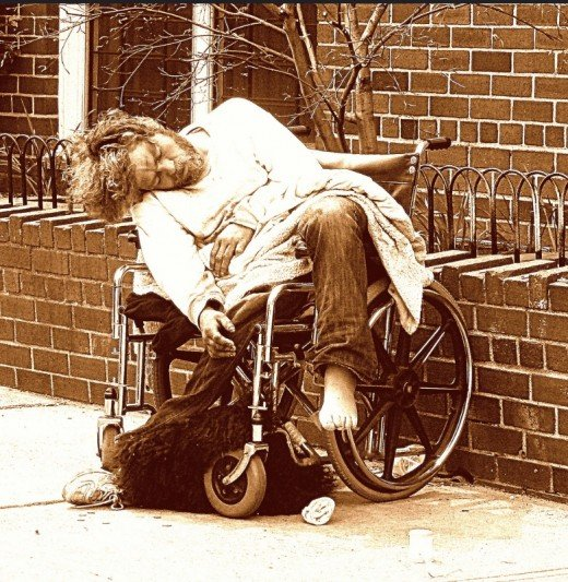 Homeless disabled man sleeping on the street in New York City, 041414.