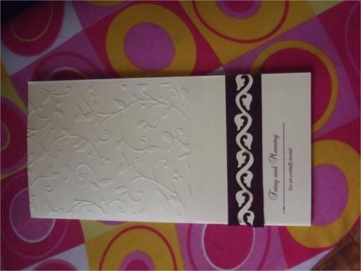 Embossed card with die cut figure