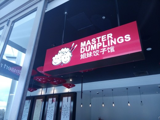 "Chinese lettering: ""Sisters' Dumpling Restaurant"". Huh."