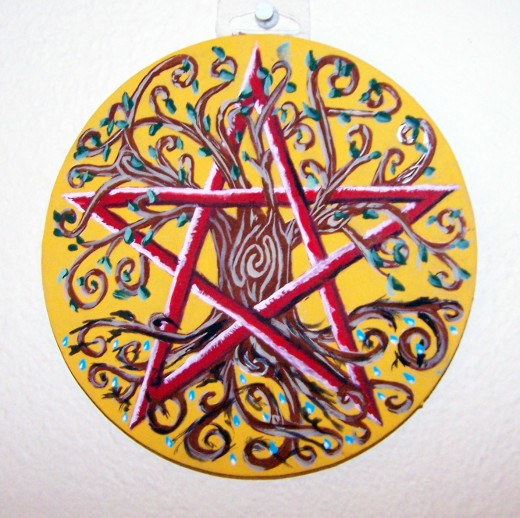 This is a pentacle (altar plaque/ritual tool) with a pentacle (star-in-a-circle shape) inscribed upon it.