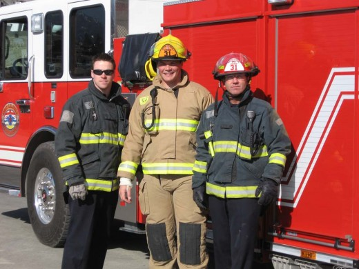 Former 2011 first round draft pick Danny Watkins (center) is now a firefighter in Dallas