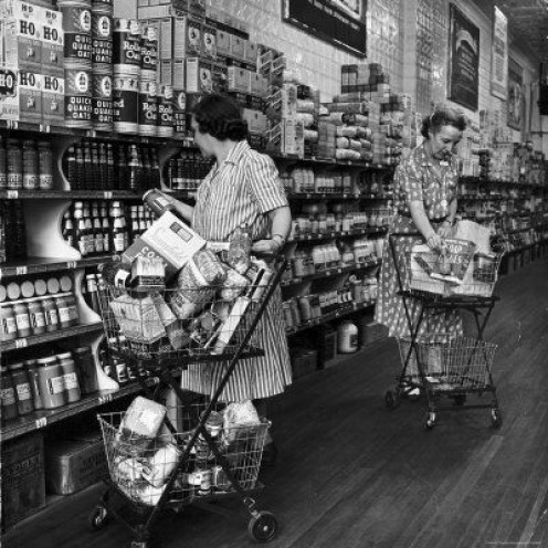 Two women shopping at  an old A & P Grocery store  in the early 1950s