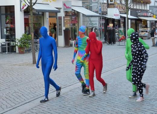 Three men dressed as?.