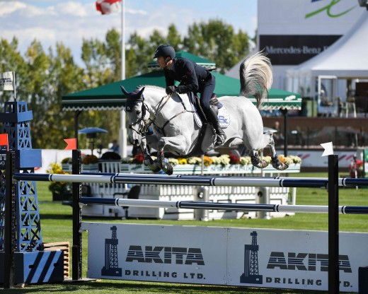 Lorenzo De Luca competing on Limestone Grey in the Akita Drilling Cup at the Spruce Meadows Masters.