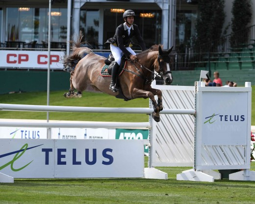 Steve Guerdat and Albfuehrens Happiness competing in the Telus Cup at the Spruce Meadows Masters in Calgary Canada.