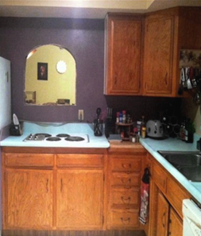 Original Kitchen - Ugly yellowed cabinets, old coil stove, unfinished window.