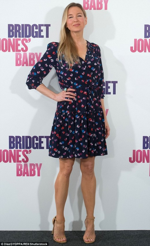 Renee Zellweger pretty in a floral dress and ankle strap high heels for Bridget Jones's Baby promotion