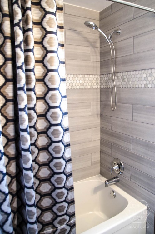 This design incorporates larger, cheaper tile alongside some gorgeous hexagonal marble tile. The two compliment each other well, and create a very fresh and unique look.