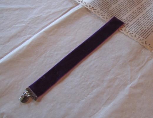 Book mark favors made with velvet ribbon.