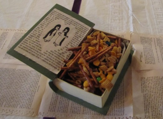 Snack mix on the tables in handmade book-shaped boxes.