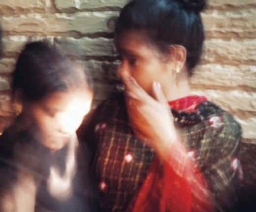 These young victims of human trafficking are seen in the doorway of a brothel in South Asia, during a rescue operation conducted by International Justice Mission (IJM). Photo copyright: IJM
