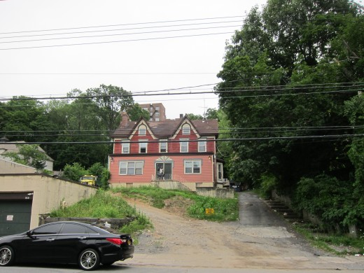 Former home of Sam Carr and his black lab, Harvey. Berkowitz's apartment building is still visible on the hillside above the Carr house.
