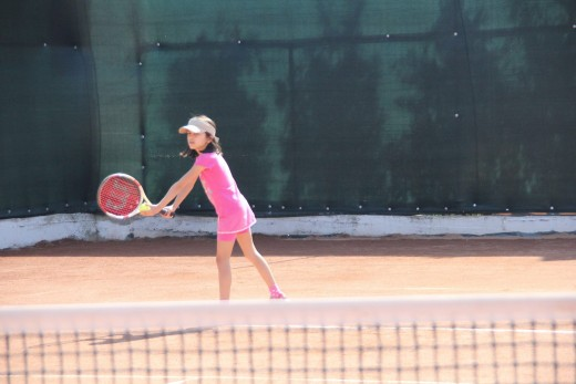 My younger daughter, Bianca, playing in a tournament (age 9)