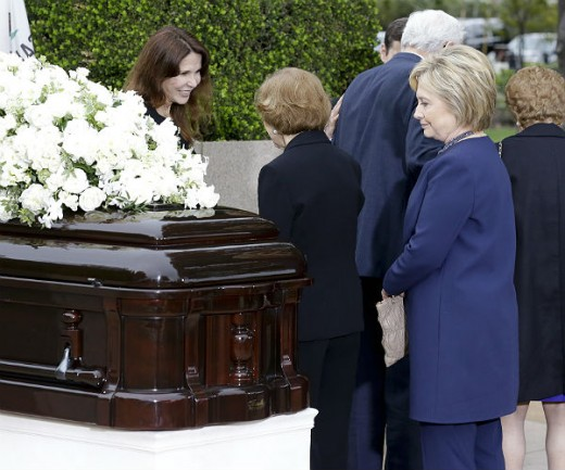 Hillary Clinton at a funeral of one of her former advisors who happened to suddenly die from unknown circumstances for unknown reasons just before he was about to release information to the media.  Notice the smile on her face.