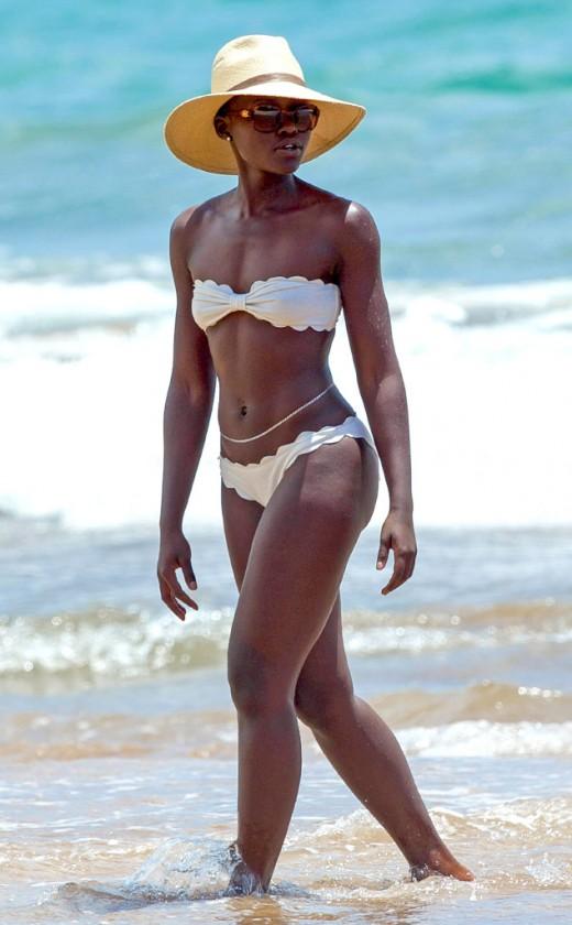 Lupita Nyong'o, happy in her own skin, the African skin.