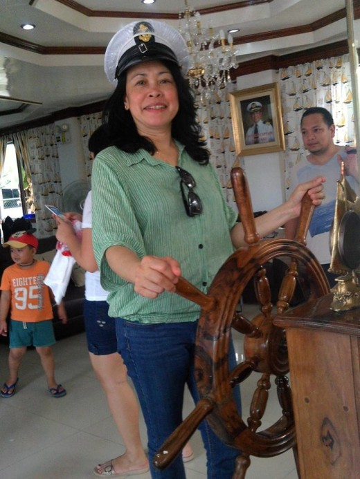 My Tita manning the wheel.