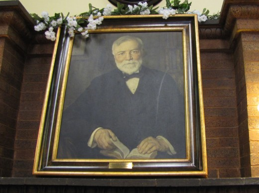 Portrait of Andrew Carnegie in a place of honor at the Carnegie Library in Eureka Springs.