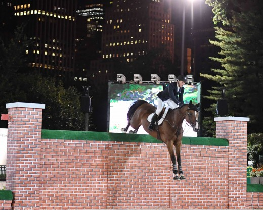 McLain Ward clearing the wall at 6'3""