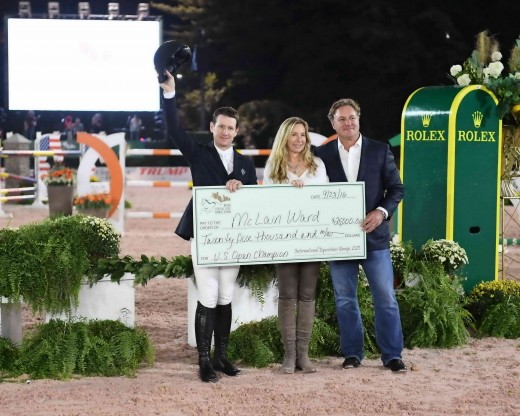 McLain Ward accepting a check for $25,000 from Mark and Katherine Bellissimo.