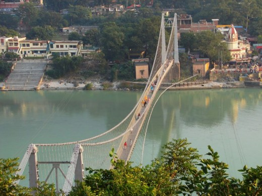 Ram Jhula Bridge as seen from the river bank of the more peaceful part of Rishikesh