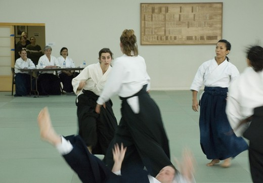 These women are demonstrating the Aikido technique of randori (multiple attackers).  Control of breathing helps maintain a calm mind.