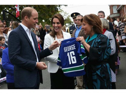 presented with personalised sports shirts for Prince George and Princess Charlotte by B.C. Premier Christy Clark at Cridge Centre for the Family
