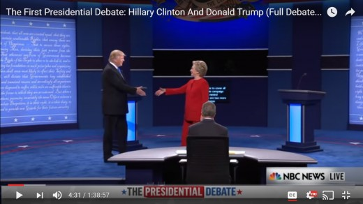 HRC moves her upper body away from the handshake as she steps in with her right foot. HRC passes center stage and is now on DJT's side of the stage. DJT's body remains square and hand opens more for a handshake.