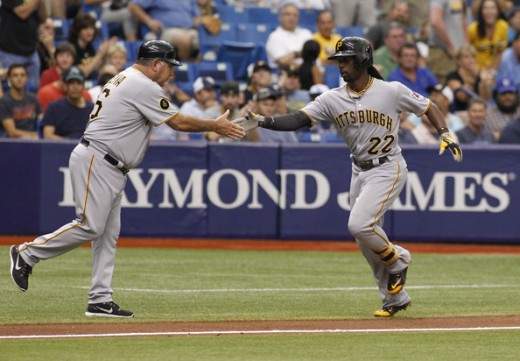 First Base Coach Nick Leyva congratulates Andrew McCutchen in a 2016 game.