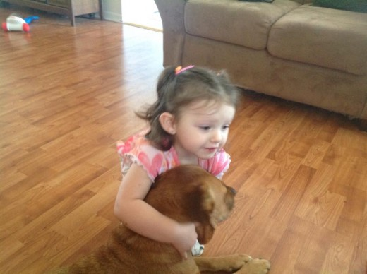 This is my niece Annabel giving Angel a hug.