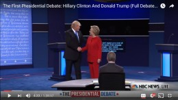 Donald Trump and Hillary Clinton shake hands.