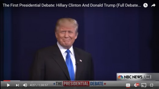 DJT is now captured by the television camera for the first time, looking toward the audience with a smile. HRC is not in this frame.