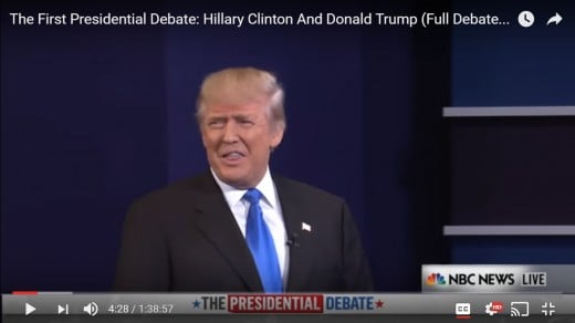 "DJT appears to say ""Thank you"" to the audience.  HRC is not in this frame.  DJT's head remains upright."