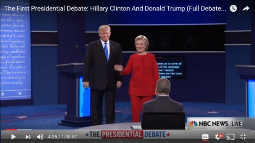 HRC begins wave toward audience. DJT stands facing audience with arms down by his side.