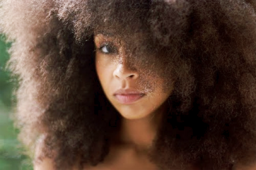 A Black woman wearing out a natural hair
