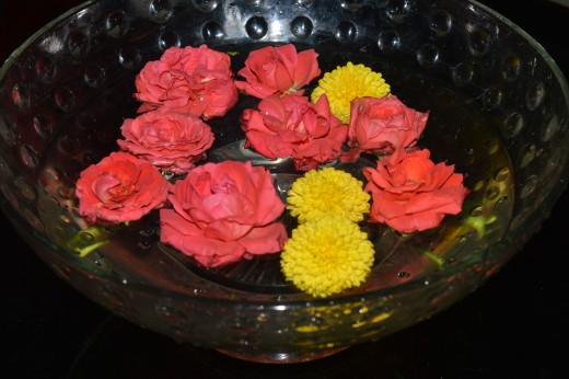 Fresh flowers  floating on water, a delight in our living room