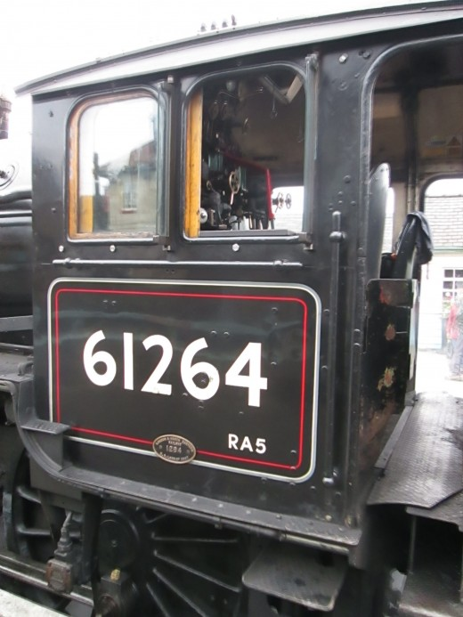 The cab of 61264 in early BR livery - note the red and cream lining around the edge of the lower cab panel, RA represents route availability and '5' had a wide range of countryside and main line routes the class could be allocated for us on