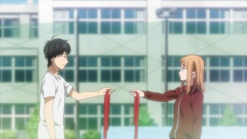 Kakeru and Naho exchanging headbands.