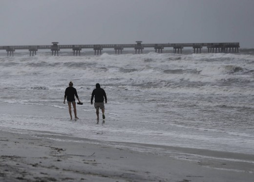 Beach goers on the beach near Daytona after hurricane Matthew has passed.