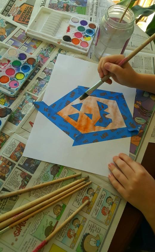 Painting a Jack-O-Lantern.