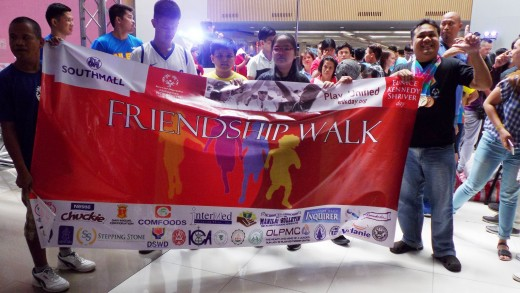 Friendship walk participants with their banner
