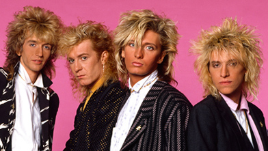 Platinum Blonde added a fourth member in Kenny MacLean on the bass pictured right.  Mark Holmes pictured centre was left to sing leads.