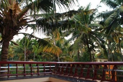 A traditional wood balcony in one of the guest houses of Varkala.