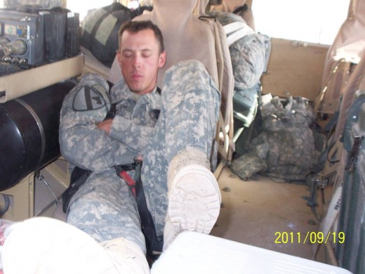 Catching a power nap before going out on a mission in Iraq.