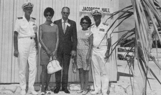 Atlantic Undersea Test and Evaluation Center (AUTEC) dedication in 1969. Captain Jackson, Mrs. Jan Jacobson Carter, George W. Jacobson, Jr., Mrs. Jacobson, and Admiral Brush in front of Jacobson Hall after its dedication by Admiral Brush.