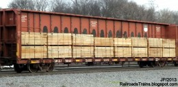 The lumber car being loaded for shipment.