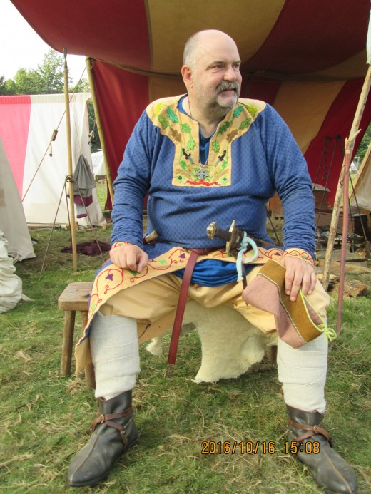Whilst most of the men gather to form the shield wall on Caldbec Hill, in the camp this well attired fellow - perhaps a thegn - regales me with background information